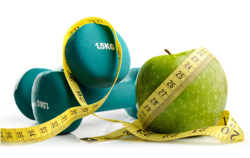 Weights, apple and a measuring tape